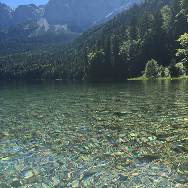 Foreground: the clear waters of Eibsee; Background: the Zugspitze, the highest mountain in Germany